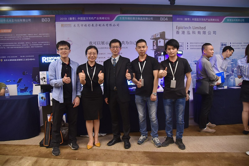 Our team takes a group photo with summit representative